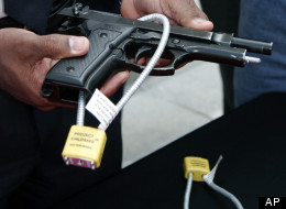 File: New Orleans Police Department Asst. Superintendent Warren Riley demonstrates how to install a gun lock at a news conference in New Orleans Tuesday, March 22, 2005.