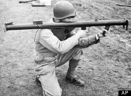 A U.S. soldier demonstrates the proper way to hold a bazooka, a launching tube used for antitank warfare, in Sept. 1943 at an unknown location.  (AP Photo/U.S. Army Signal Corps)