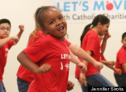 """Kids join in the filming of Catholic Charities' video for Beyoncé's Let's Move anthem, """"Move Your Body."""" (Jennifer Sirota)"""