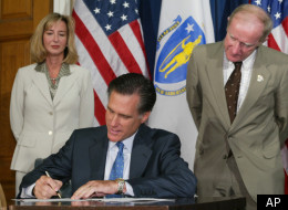 Mitt Romney signs legislation to extend the Massachusetts' ban on assault weapons on July 1, 2004.