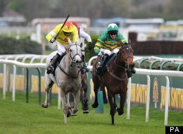 Neptune Collonges ridden by Daryl Jacob (left) races against Sunnyhillboy ridden by Richie McLernon (right)