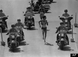 Alberto Salazar of Wayland, Mass., looks over his shoulder to check on Dick Beardsley, rear, of Rush City, Minnesota, as they neared the finish line April 19, 1982 in the 86th annual Boston Marathon.