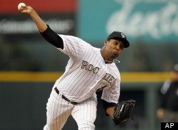 Colorado Rockies starting pitcher Juan Nicasio delivers a pitch to San Diego Padres leadoff batter Will Venable in the first inning of a baseball game in Denver on Wednesday, April 18, 2012. (AP Photo/David Zalubowski)
