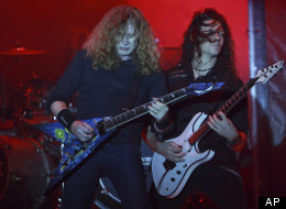 Dave Mustaine, left, and Cris Broderick, of the U.S. trash metal band Megadeth perform in concert in La Paz, Bolivia, Friday Nov. 25, 2011. (AP Photo/Juan Karita)