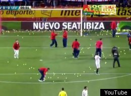 Sevilla fans protested the start time of their match against Levatne with tennis balls.