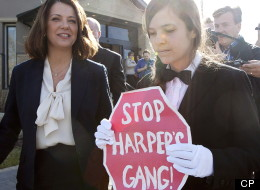Brigette DePape, the rogue page who held up a 'Stop Harper' sign in the House of Commons, protested at the polling station where Alberta Wildrose Party leader Danielle Smith voted on April 23, 2012. (CP)