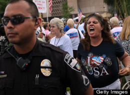 Tea Party activist Allison Culver shouts at opponents during a demonstration against illegal immigration on July 31, 2010 in Phoenix, Arizona. (File photo by John Moore/Getty Images)