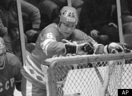 NHL All-Stars Bobby Clarke heads for the ice behind the Soviet Nationals net in the third period of the third game in the Challenge Cup series in New York on Sunday, Feb. 12, 1979. Behind him are Soviet defencemen Sergie Babinov (4) and Valeri Vasilyev (6). The Soviet team won 6-0 and took the cup 2-1 in games. (AP Photo/Bill Kostround)