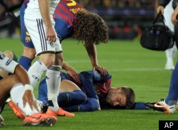 FC Barcelona's Gerard Pique', bottom right, lies on the pitch after colliding with Chelsea's Didier Drogba, left, during a Champions League 2nd leg semifinal soccer match at the Camp Nou, in Barcelona, Spain, Tuesday, April 24, 2012. (AP Photo/Felice Calabro')