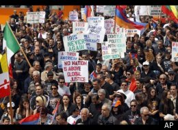 Thousands of demonstrators march to mark the death of 1.5 million Armenians in the former Ottoman empire, in Los Angeles Tuesday, April 24, 2012. (AP)