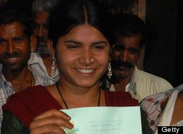 Indian woman Laxmi Sargara, 18, holds her certificate of the annullment of her marriage outside the court in Jodhpur on April 24, 2012. (STR/AFP/Getty Images)