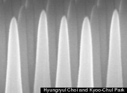 Through a process involving thin layers of material deposited on a surface and then selectively etched away, the MIT team produced a surface covered with tiny cones, each five times taller than their width. This pattern prevents reflections, while at the same time repelling water from the surface.