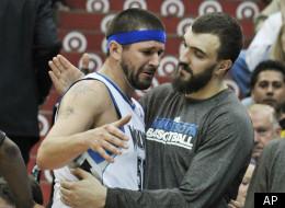 An emotional Brad Miller hugs Timberwolves teammate Nikola Pekovic after getting taken out of his last game ever.