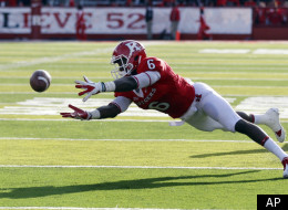 Rutgers wide receiver Mohamed Sanu (6) stretches for a pass during an NCAA college football game against Cincinnati in Piscataway, N.J., Saturday, Nov. 19, 2011. Rutgers won 20-3. (AP Photo/Mel Evans)