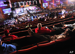 A fan rests in the mezzanine nearing the end of the third round of the NFL football draft at Radio City Music Hall, Friday, April 27, 2012, in New York. (AP Photo/John Minchillo)