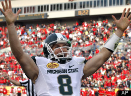 Michigan State quarterback Kirk Cousins celebrates his fourth-quarter touchdown pass to wide receiver Keith Nichol during the Outback Bowl on Jan. 2, 2012.