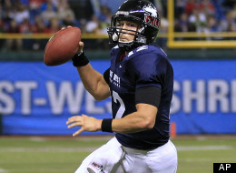Chandler Harnish, of Northern Illinois University, runs three yards for a touchdown during the East-West Shrine Classic NCAA college football game on Saturday Jan. 21, 2012.