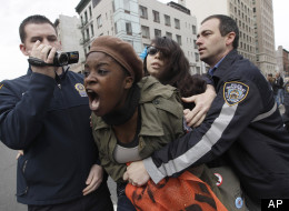 Police officers detain a couple of Occupy Wall Street activists during a march to call for NYPD Police Commissioner Ray Kelly's immediate resignation, Saturday, March 24, 2012 in New York. (AP Photo/Mary Altaffer)
