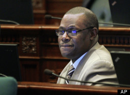 Illinois Rep. Derrick Smith, D-Chicago, is seen on the House floor during session Tuesday, April 17, 2012 at the Illinois State Capitol in Springfield, Ill. Smith has been largely absent from the capital since his March 13 arrest on a federal bribery charge. He was indicted on April 10, 2012 for allegedly accepting $7,000 in exchange for his support of a grant application. (AP Photo/Seth Perlman)