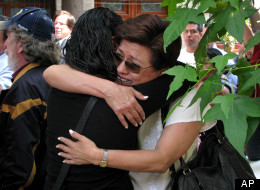 Journalists embrace each other during a demonstration condemning the alleged murderer of fellow journalist Regina Martinez in Mexico City, Sunday, April 29, 2012. (AP Photo/Marco Ugarte)