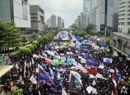 Phillippines citizens march through the capital, Manila, to celebrate May Day