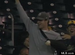 Padres fan David West celebrates after catching a foul ball despite having an arm in a cast. (Credit: MLB.com)