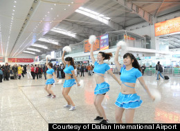 An airport in China brought in cheerleaders to keep passengers calm after a fog stranded 5,000 people.