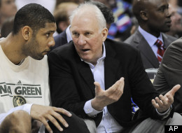 San Antonio Spurs head coach Gregg Popovich, right, talks to Tim Duncan during the second half of an NBA basketball game against the New Orleans Hornets, Friday, April 6, 2012, in San Antonio. San Antonio won 128-103. (AP Photo/Darren Abate)