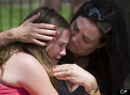 Skye Soutar (left) is consoled by her mother Pam after leaving the funeral for seven-year-old Katelynn Sampson in Toronto on Tuesday August 12, 2008. Hundreds of mourners grieved at the funeral for a seven-year-old girl who was found dead in her caregiver's apartment with savage injuries that shocked even hardened police officers.