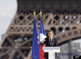 France's President and candidate for re-election in 2012, Nicolas Sarkozy, gestures as he delivers a speech during a campaign meeting at Tocadero square in Paris, Tuesday, May 1, 2012. Eiffel tower in the background. (AP Photo/Michel Euler)