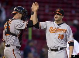 Baltimore Orioles' Chris Davis, right, celebrates with teammate Matt Wieters, left, after the Orioles defeated the Boston Red Sox 9-6 in 17 innings in a baseball game at Fenway Park, in Boston on Sunday, May 6, 2012. Davis, a first baseman, pitched two innings to earn the win. (AP Photo/Steven Senne)
