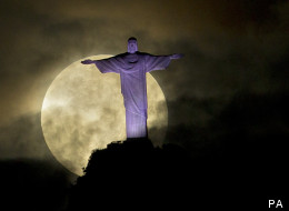 The supermoon as seen behind the Christ the Redeemer statue, Rio de Janeiro, Brazil