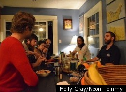 Members of Synchronicity share a meal inside their communal West Adams home. (Molly Gray/Neon Tommy)