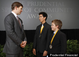 Eli Manning with two of 2012's Prudential Spirit of Community Awards honorees.