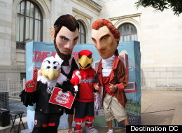 Local sports mascots, from left, Talon, Abe, Screech and TJ, joined local tourism leaders at the Carnegie Library on Mount Vernon Square on Tuesday to announce new tourism spending figures for the District of Columbia.