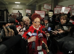 Registered Nurse Martese Chism, with National Nurses United talks to the media, during a protest by nurses at City Hall, Monday, Oct. 24, 2011, in Chicago.