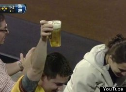 A fan catches a foul ball in his beer during the Padres game on Tuesday night.