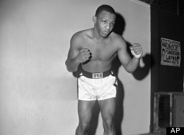 """Shown in photo is fighter Eddie Perkins for """"tale of the tape"""" . They fight for junior welterweight crown on Dec. 15, 1962 in Milan. (AP Photo)"""