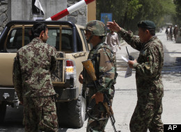 Afghan National Army soldiers secure the gate of the military hospital after Arsala Rahmani, a former Taliban official turned Afghan peace negotiator, was killed by an unknown attacker in western Kabul, Sunday, May 13, 2012. (AP Photo/Rahmat Gul)