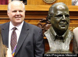 Rush Limbaugh and a bust in his likeness at his induction into the Hall of Famous Missourians, May 14, 2012. (Photo credit: Progress Missouri)