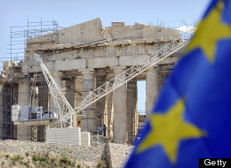Workers on scaffolding work in front of the Parthenon Temple at the Acropolis archaeological site in Athens on May 9, 2012. (LOUISA GOULIAMAKI/AFP/GettyImages)