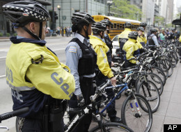 Chicago Police bicycle units officers block the entrance to a Bank of America branch while about 50 Occupy Chicago activists gather outside, as part of a May Day demonstration, Tuesday, May 1, 2012, in Chicago. The May Day protests were considered to be a preview of what to expect during the NATO summit in Chicago. (AP Photo/M. Spencer Green)