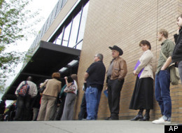 In this April 24, 2012, photo shows job seekers waiting in line during a job fair, In Portland, Ore