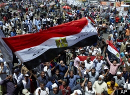 Protesters wave an Egyptian national flag and chant slogans at a rally in Tahrir Square in Cairo Egypt, Friday, April 27, 2012. (AP Photo/Fredrik Persson)