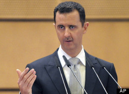 In this photo released by the Syrian official news agency SANA, Syrian President Bashar Assad deliver a speech at Damascus University, Syria, Tuesday, Jan. 10, 2012. (AP Photo/SANA)