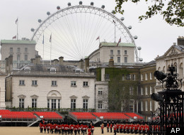 A view across Horse Guards Parade in London, as a rehearsal for Trooping the Colour takes place. The London 2012 Beach Volleyball will be held in Horse Guards Parade, and the offices of the Scotland Office have windows which look out across the venue. (AP Photo/Kirsty Wigglesworth)