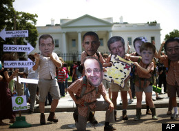 Oxfam activists wearing masks depicting G8 world leaders participate in a demonstration outside the White House in Washington, Thursday, May 17, 2012. President Barack Obama will welcome G8 leaders to his presidential retreat at Camp David, Maryland.(AP Photo/Pablo Martinez Monsivais)