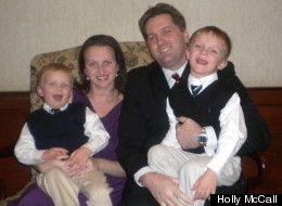 Holly McCall, shown with her husband Chris and her sons, is trying to change credit card rules.