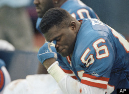 New York Giants linebacker Lawrence Taylor (56) rests on the bench near the end of season opener against the San Francisco 49ers at Giants Stadium in East Rutherford, N.J. on Sunday, Sept. 7, 1992.