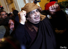 Libyan strongman Moamer Kadhafi gestures as he arrives at the Rixos hotel in the capital Tripoli on March 8, 2011. (MAHMUD TURKIA/AFP/Getty Images)